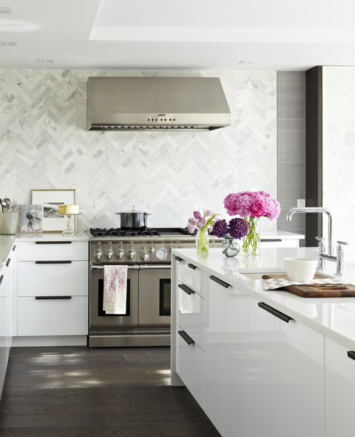I love the larger scale tiles chosen for the herringbone patterned backsplash. Can you believe this is an IKEA kitchen? See more images below of the entire kitchen makeover. Design by: Croma Designs, Photos by: Virginia Macdonald