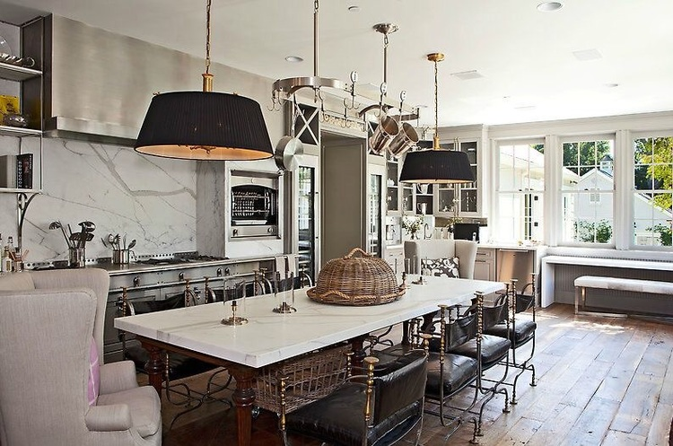 Vintage Jansen armchairs chosen for the center island are the perfect period style pieces to add a feeling of European hierarchy to the kitchen's contemporary finishes. The solid oak floors by Exquiste Surfaces, chosen for multiple areas of the home invigorates a rustic look against the fresh white walls and gray cabinetry.