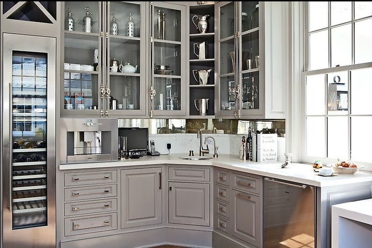 Custom cabinetry painted in Benjamin Moore's Galveston Gray and hardware by The Golden Lion.