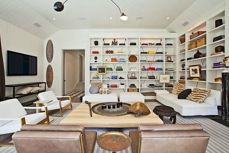 The decor here is somewhat formal and casual with high-end fabrics chosen in natural fibers mixed with soft leathers and brass finishes. Walls covered in Benjamin Moore's White Dove and Galveston Gray trim.