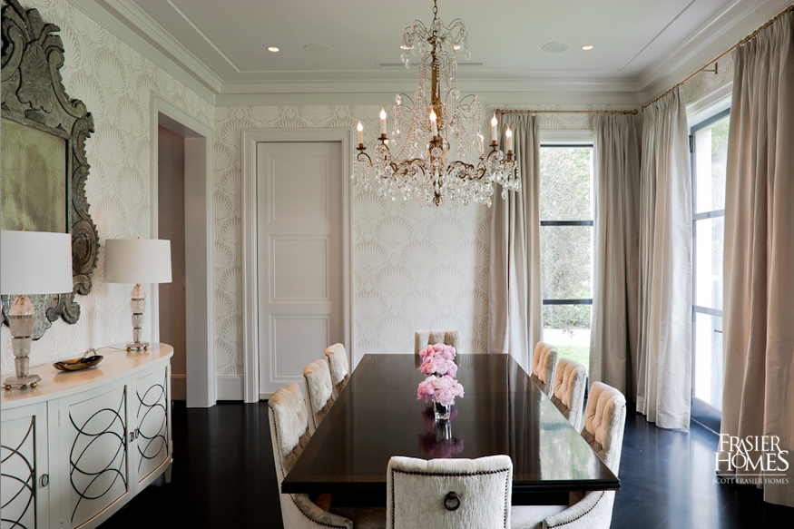Farrow & Ball's The Lotus Papers wallpaper (hung upside down for visual effect) and formal dining table from Trosby Furniture.
