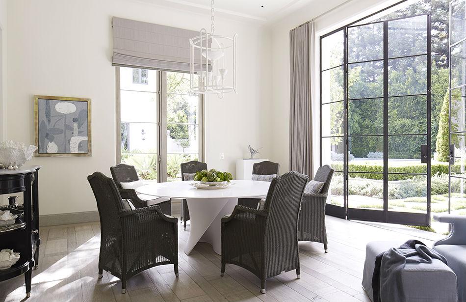 {Table, MDF Italia; Chairs, Janus et Cie; Light fixture, Stephen Antonson; Curtains, Libeco linen; Art, Matthew Brannon}