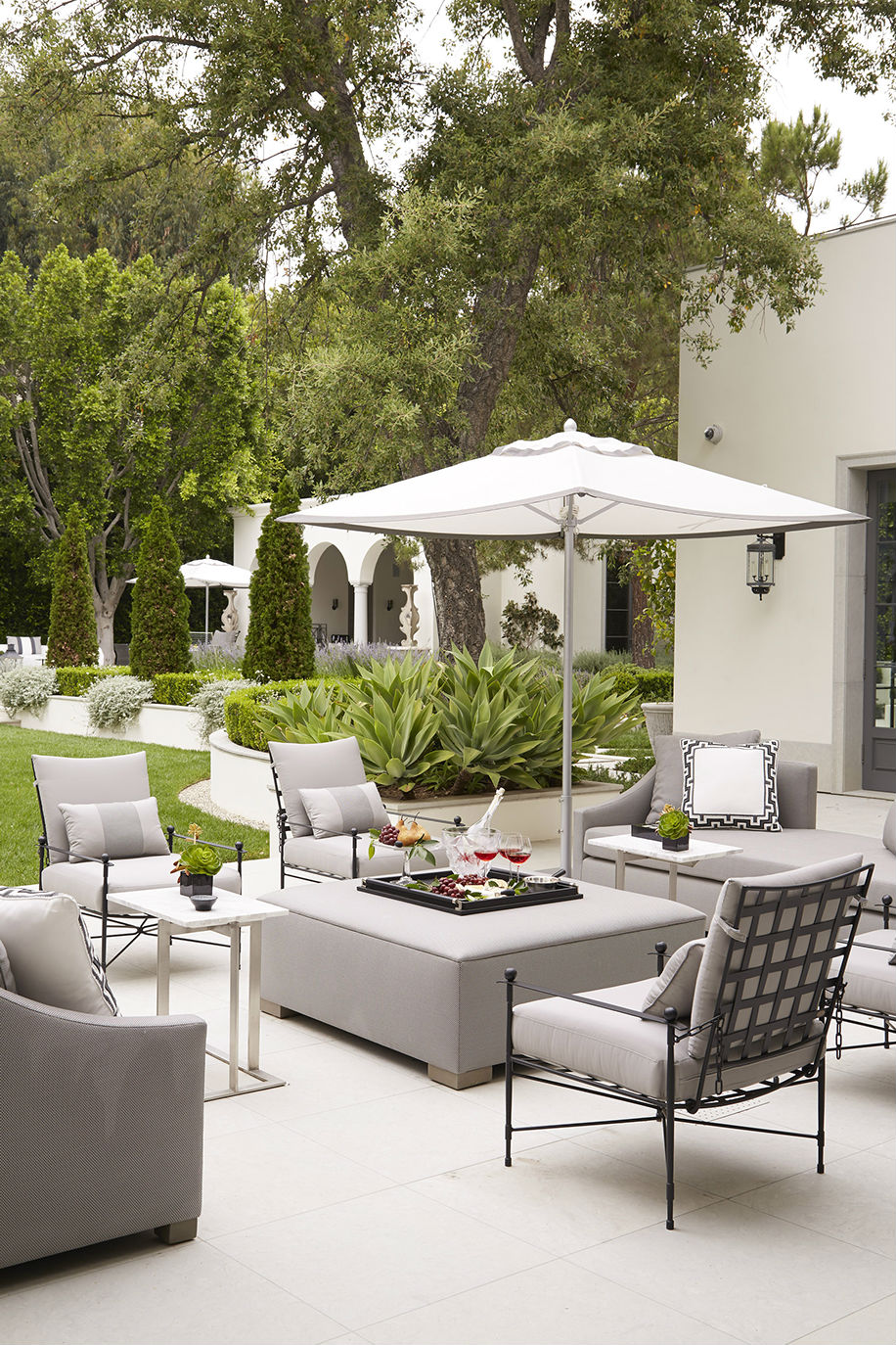 {Amalfi Living chairs, Giati fabric; Umbrella, Summit Furniture}