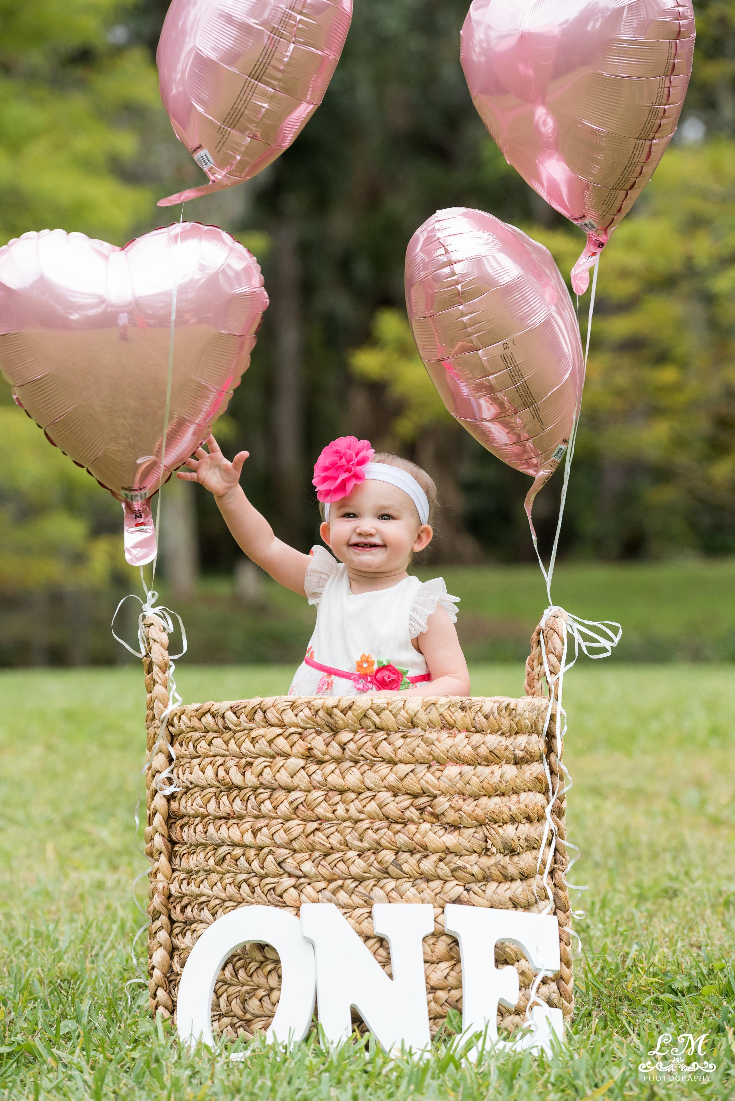 birthday girl with ballons