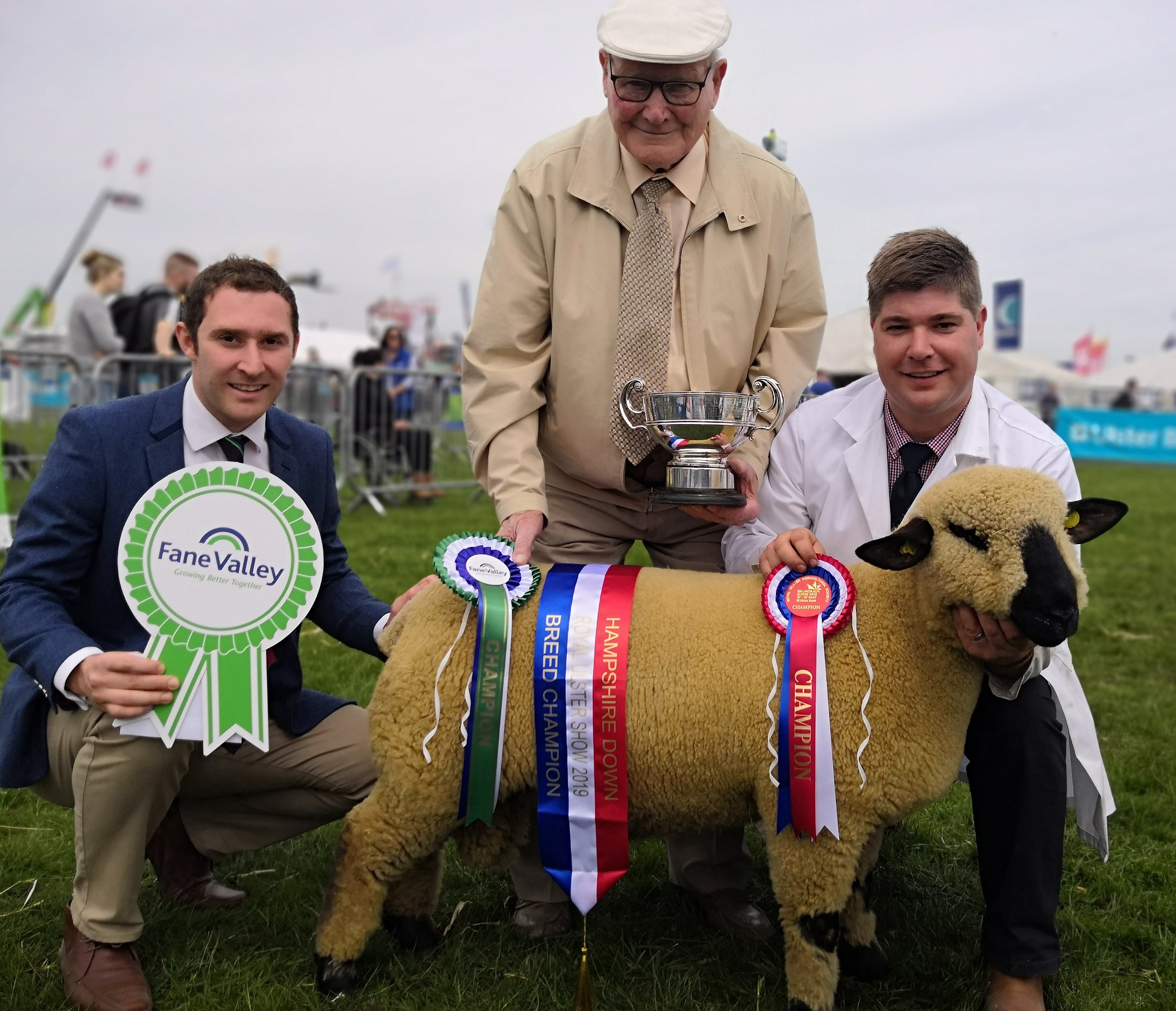 Breed Champion Brian Kennedy with sponsors and judge. Ram Lamb from CHERRYFIELD FLOCK