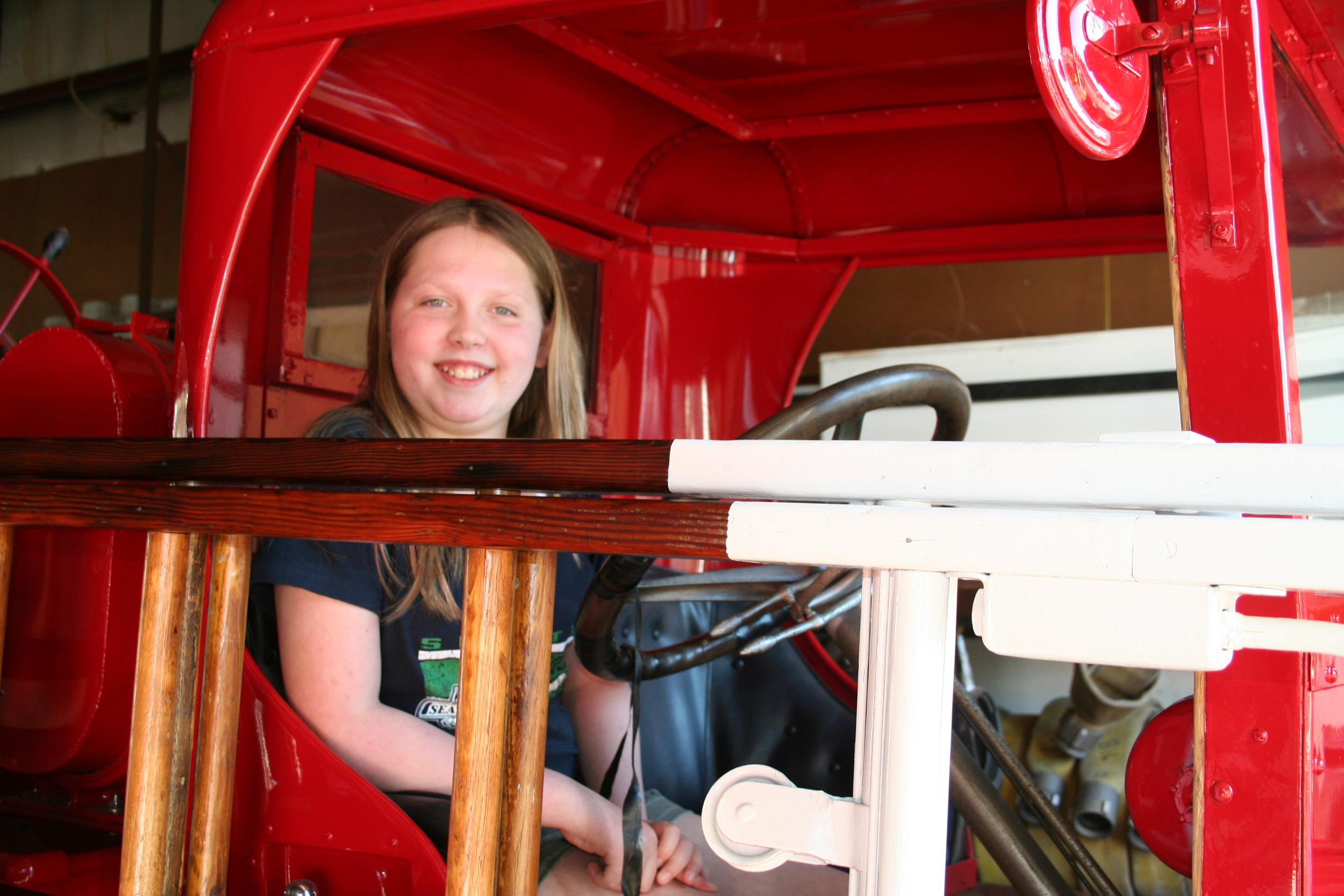 Fifth-grader Grace Nesbit in the historic fire truck at the fire station on Key Peninsula.