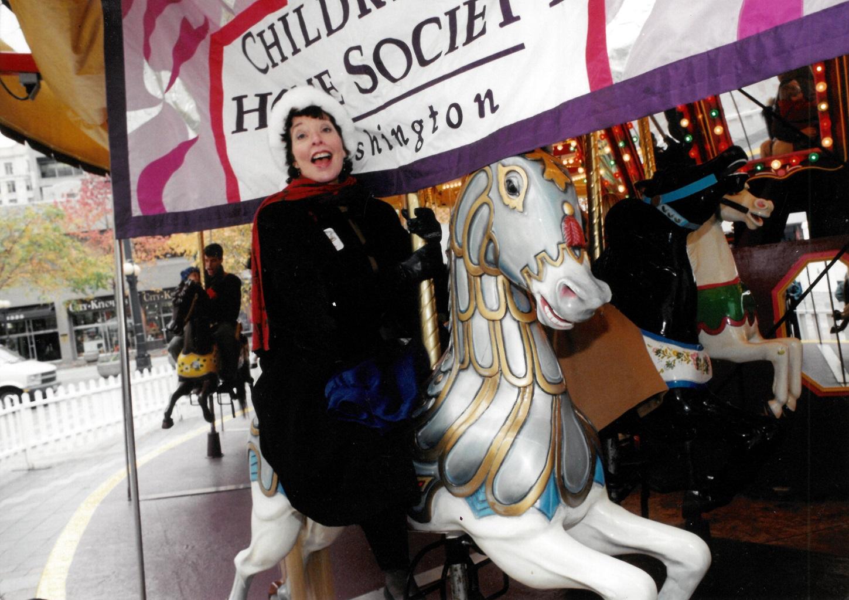Sharon-on-merry-go-round.jpg