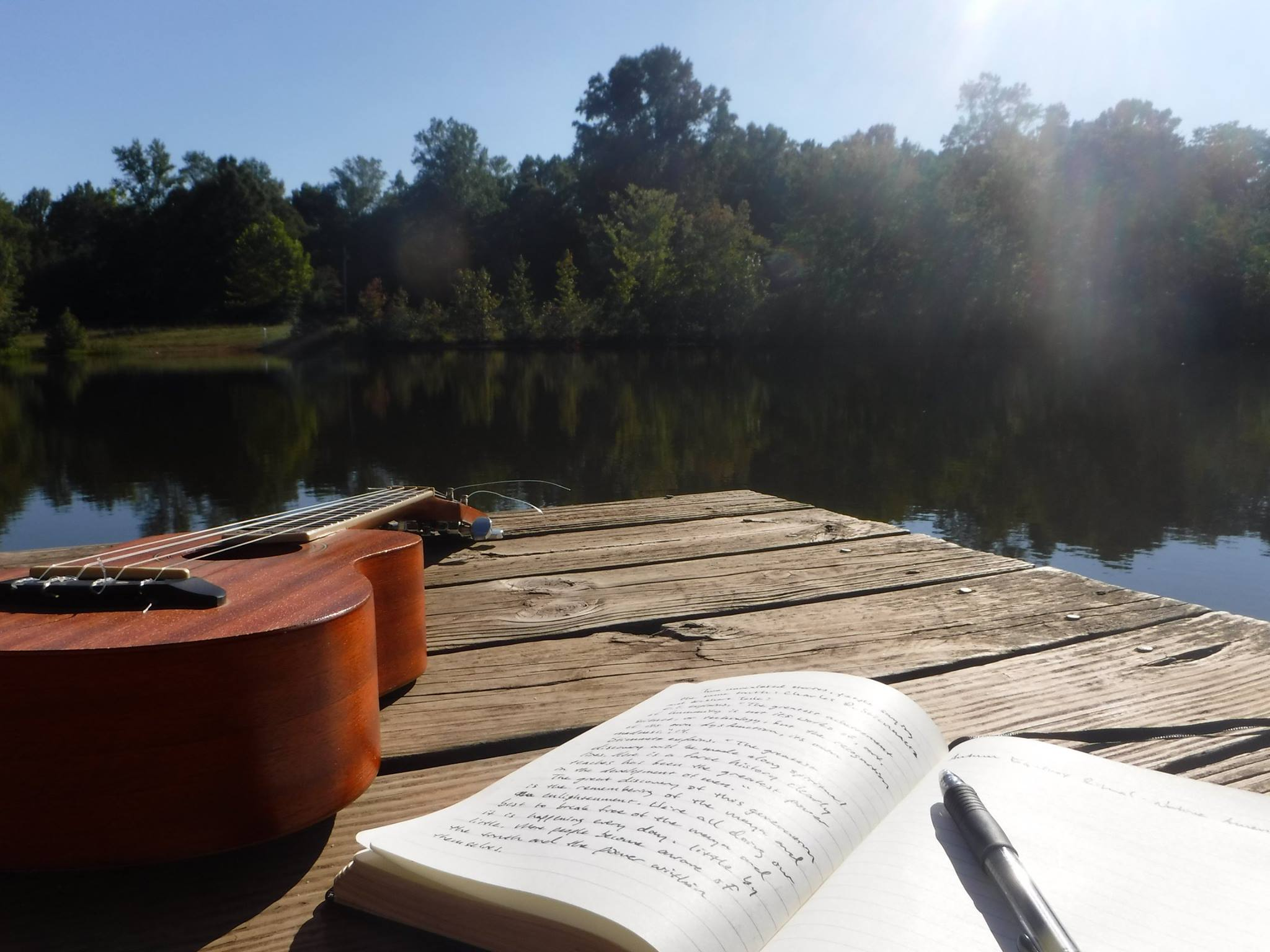 odyssey fellows - guitar and journal on dock.jpg