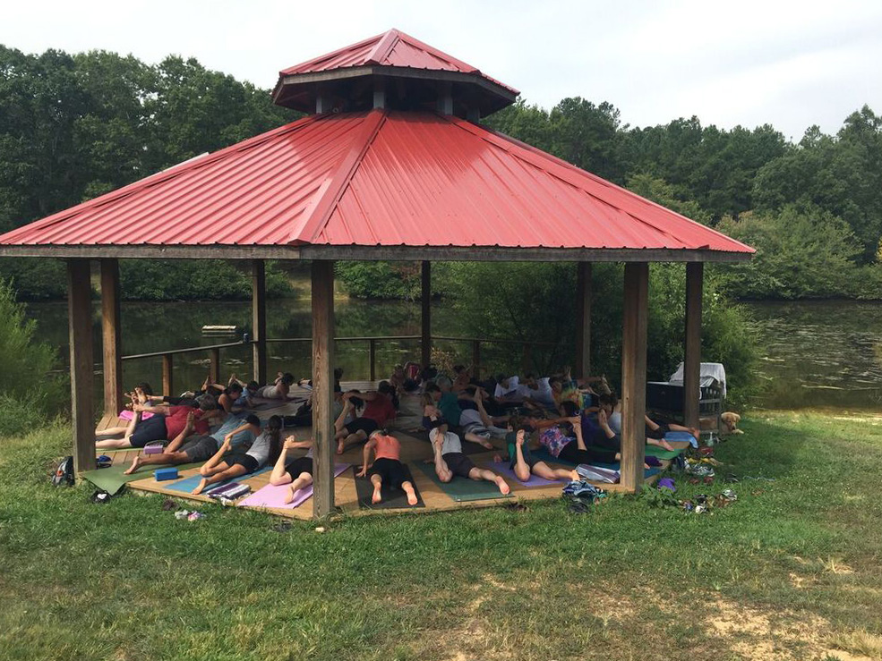 the_eco-institute_fall_autumn_megan toben_morning practice_yoga_meditation_dock_lake_gazeebo_rising-earth.jpeg