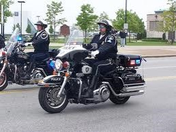 Lt. bill crates rides in a parade