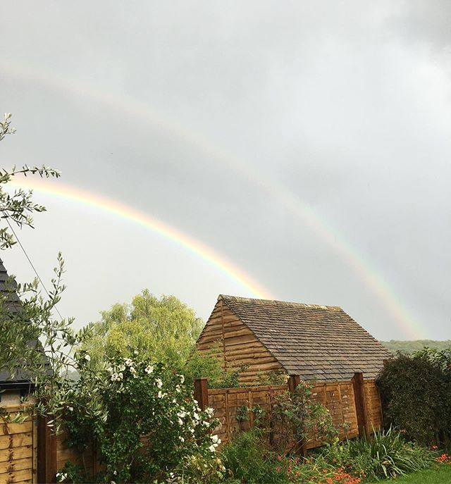 As dismal and dreary as this summer's weather has been, at least we get thrown sights like this as a consolation prize every so often. 🌈  #doublerainbow #britishsummer #englishcountryside #cotswolds #luckyrainbow #butseriouslyenoughwiththerain