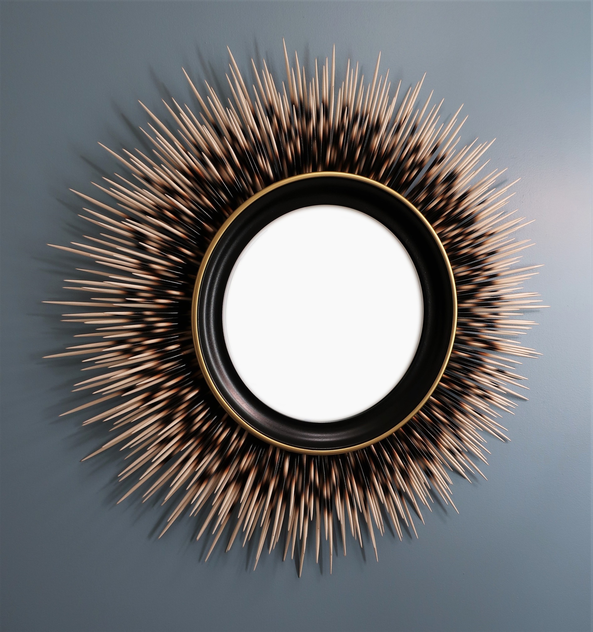 "31"" ivory-tip porcupine quill mirror with black frame and gold accent border"