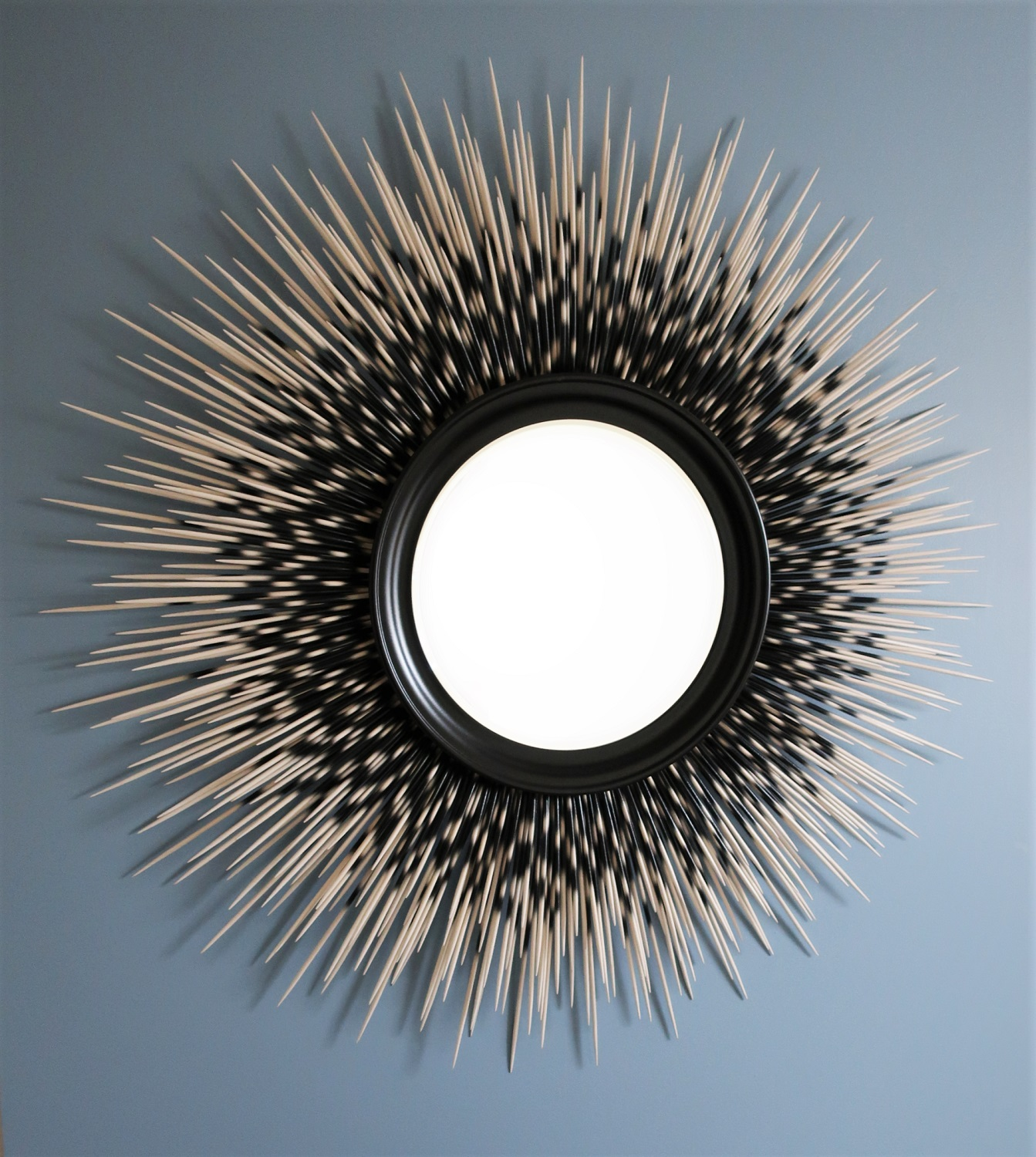 "43"" white-tip porcupine quill mirror with black frame"