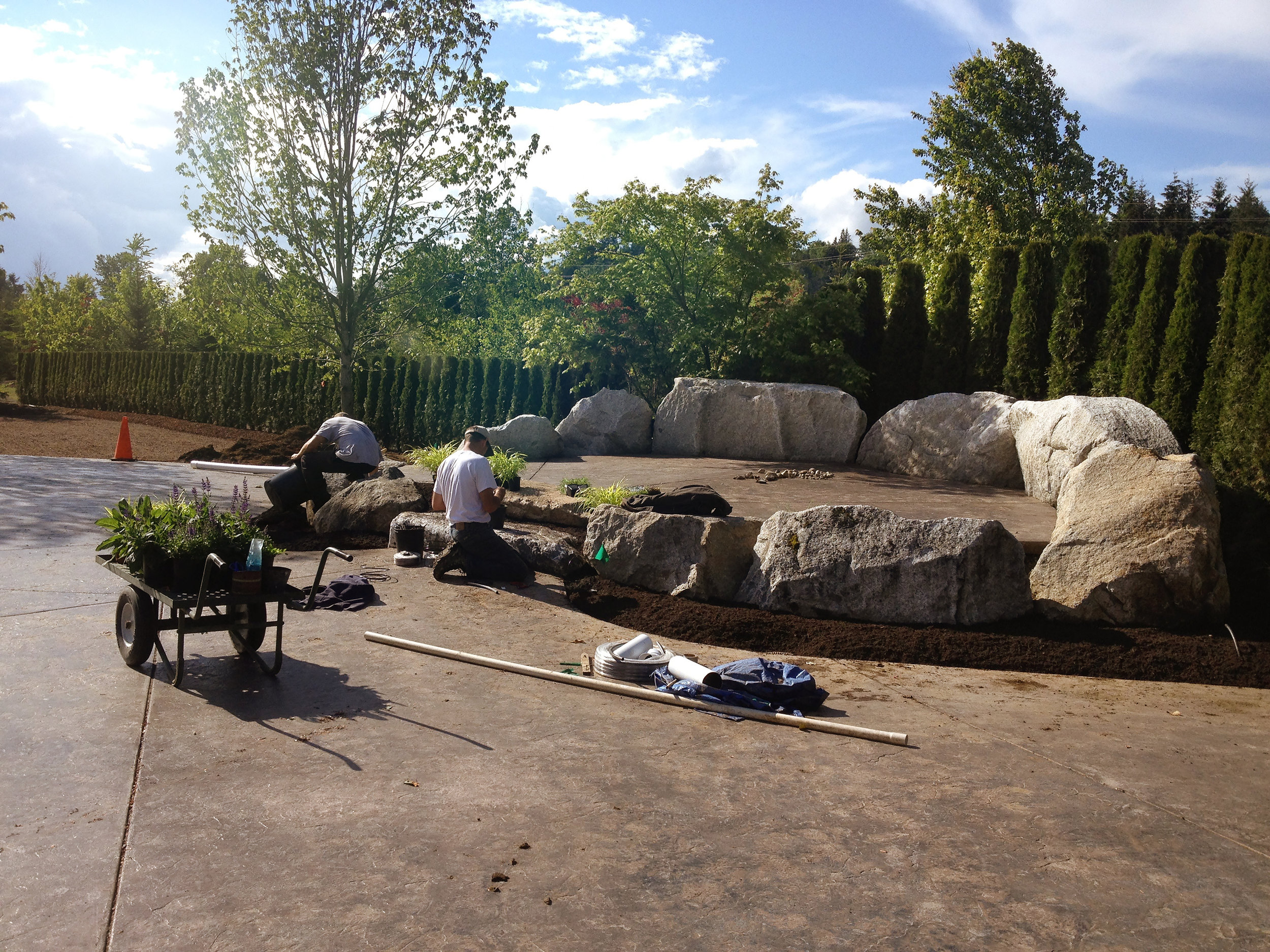 Paul planting up the beds around the granite rock stage. circa 2013