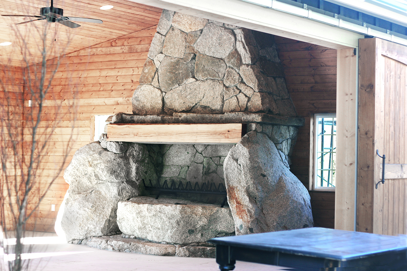 A grand fireplace - Is the gorgeous focal point in our rustic and elegant event building! A work of art!