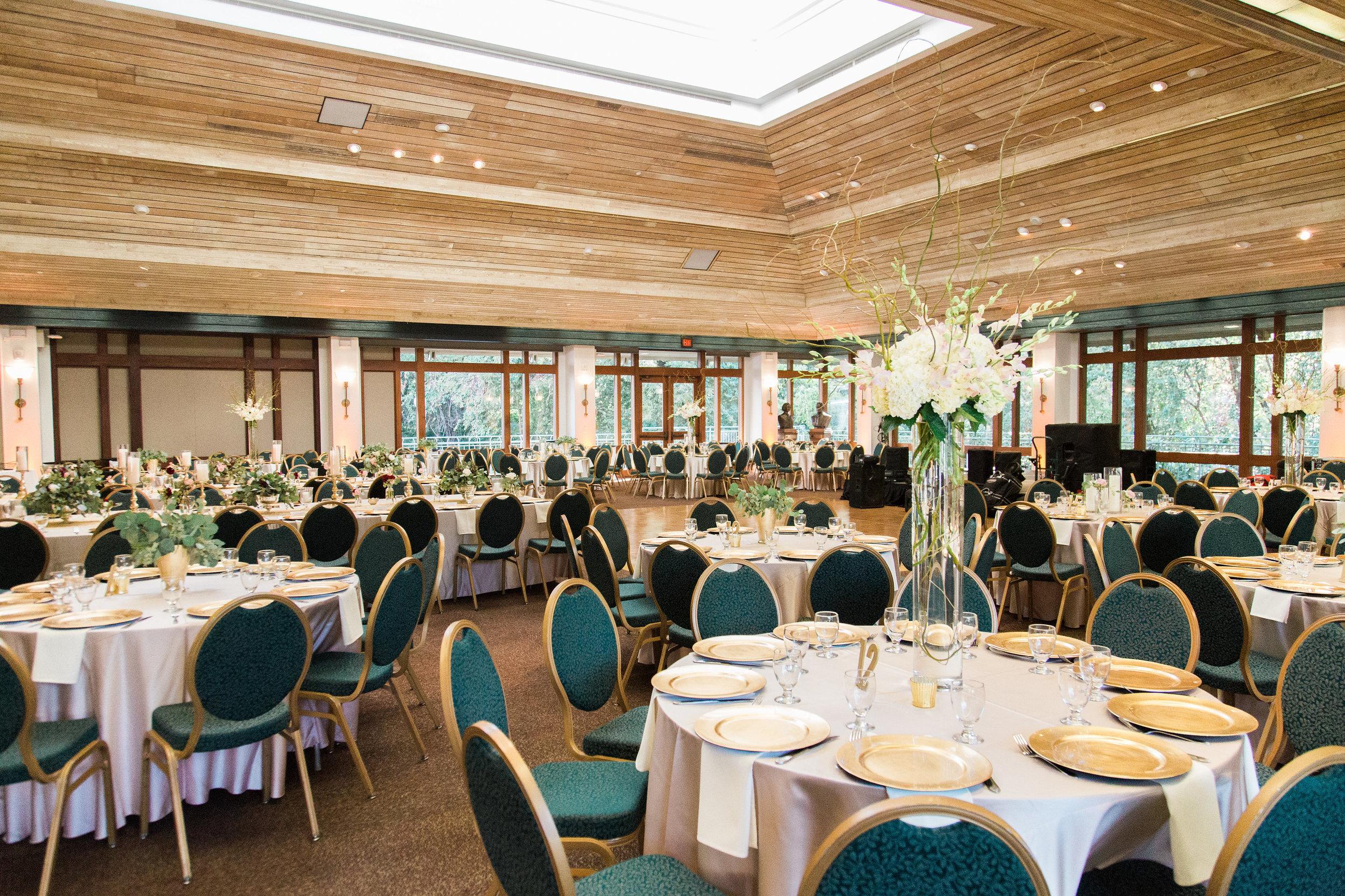 full seating for wedding reception in ballroom