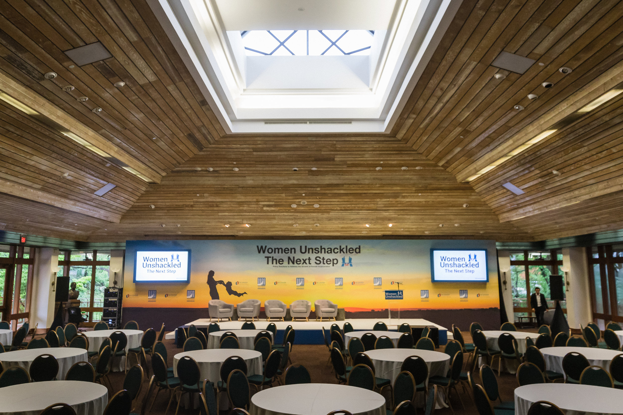 corporate build out with stage and panel in ballroom in downtown Austin