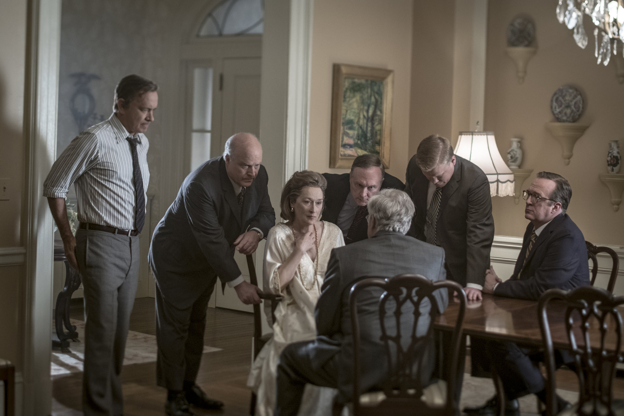 Meryl Streep as Kay Graham, a woman with the ultimate decision-making power, surrounded by her male colleagues. Credit: E One