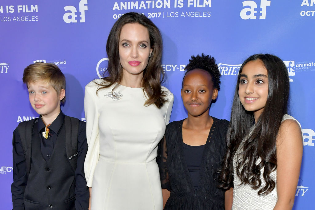 Angelina Jolie with two of her children and Saara Chaudry, the voice of Parvana ( extreme right) CREDIT: Getty