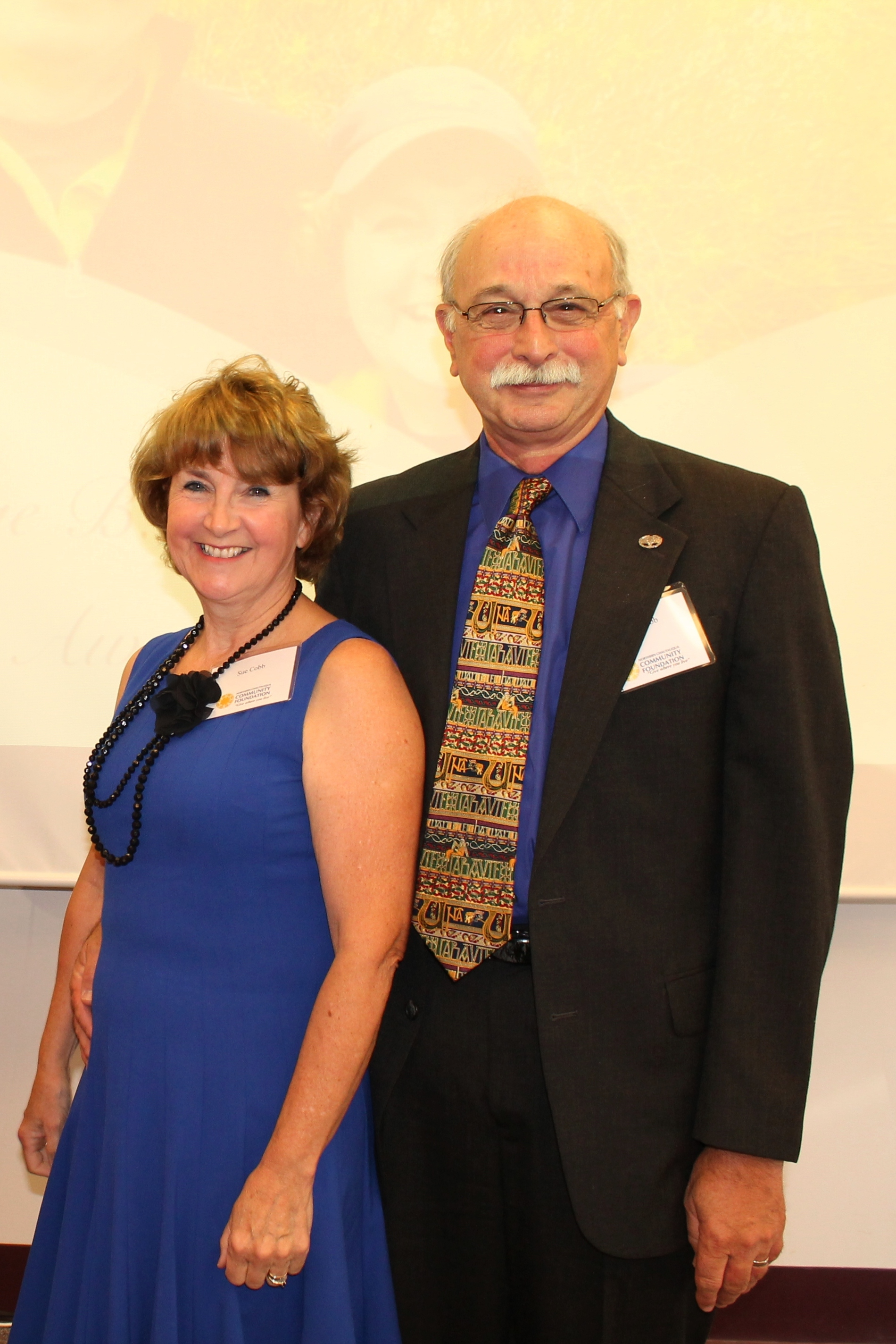 2013 - The Cobbs - Sue and Steve Cobb were chosen for the 2013 Footprints Award for their contributions to not only the youth in Fredonia but to the community at large.As a major force in Quest Program in the Fredonia Middle School, the Cobb's dedication allowed the program to expanded into Brocton Central School. They donate time to prepare students through Thursday classes for months before hikes; meeting with parents, a one-day hike, a two-day hike and ending with a three-day hike. Through the Quest program, the Cobbs are developing future stewards of our natural environment and future leaders of our community.As with the Quest program, the Cobb's dedicate extra time to students participating in the Fredonia High School musicals. Steve assists with set design, building, creating, set finisher and stage crew manager while teaching students these skills along the way. Sue works along side Steve but also works on props and costumes while teaching students as she works.Steve served as the Deputy County Disaster Coordinator, on the Fredonia Village Board, is an EMT with the Fredonia Fire Department.Both Sue and Steve have gone out of their way as educators to support students in athletics and in student travel. The couple have also opened their home to foreign exchange students.