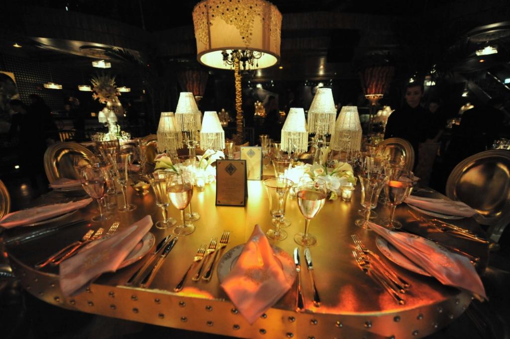 7. Jennifer Lopez 40th birthday, gold studded tables, gold lounge.jpg