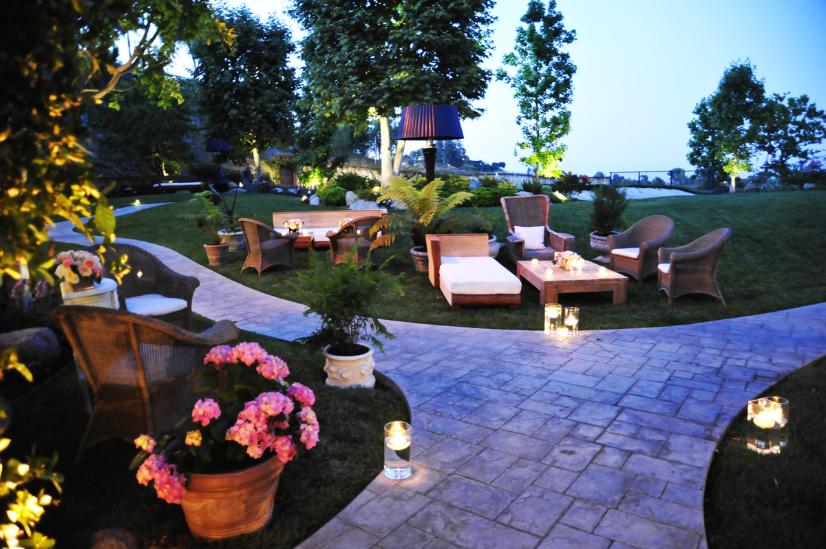 002-outdoor event lounge, wicker event furniture, garden event lounge, floating candles, .jpg