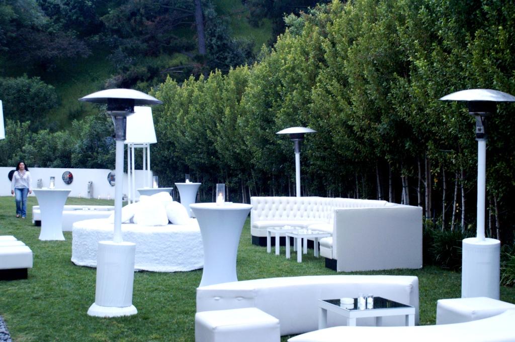 042. White Lounge ottmans,sleek white setting, white event.jpg