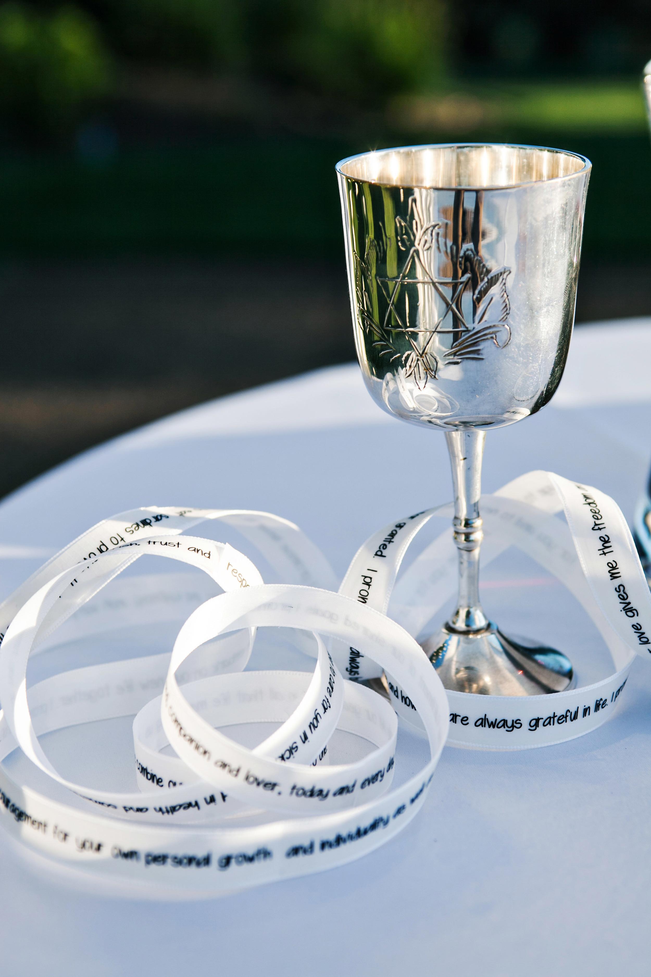 08. RS - Ceremony vows on ribbon, kiddish cup, napa wedding, jewish wedding, vineyard ceremony.jpg