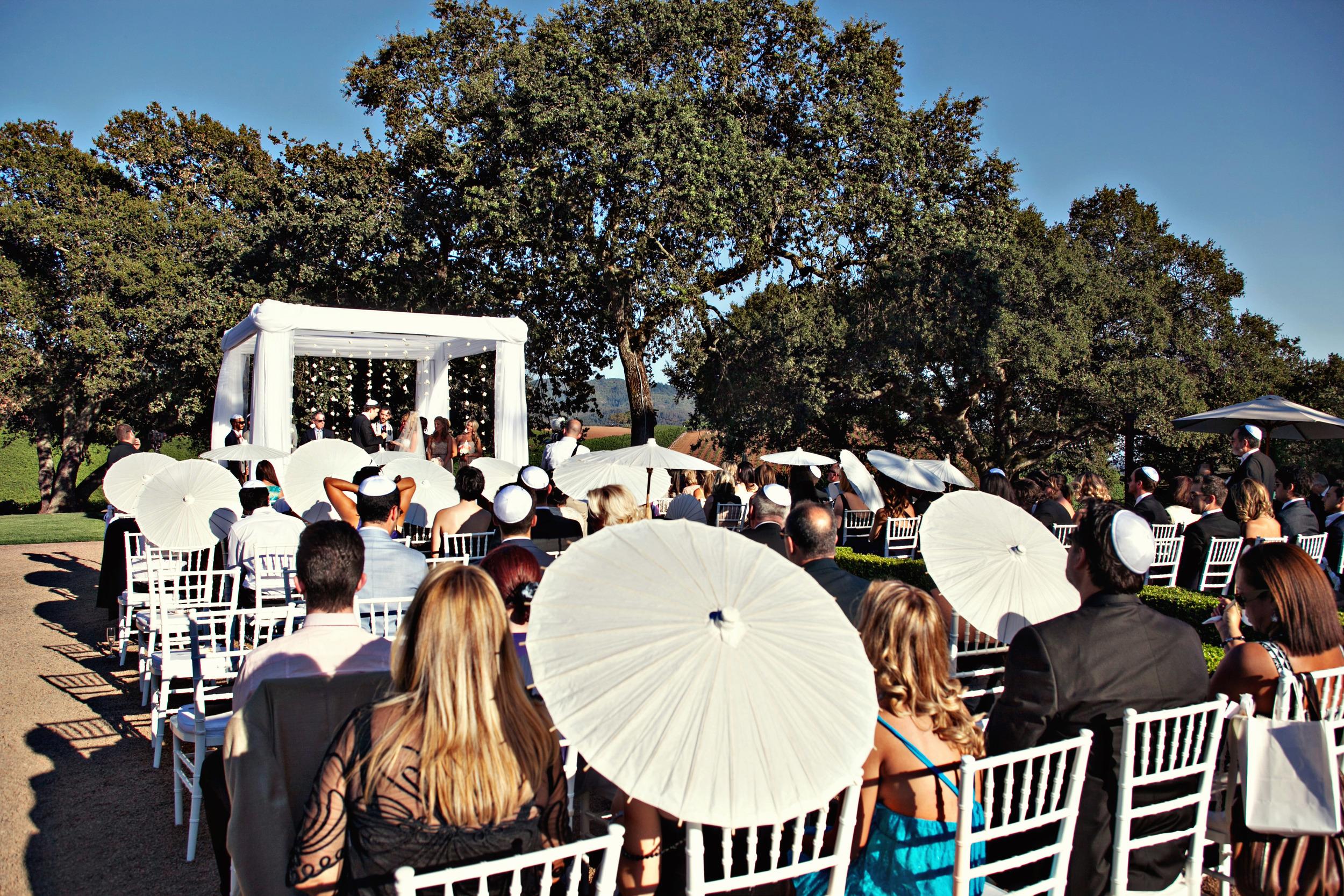 14. chuppah, hanging flowers, wedding fans, wedding parasols, vineyard ceremony, gorgeous wedding ceremony setting.jpg