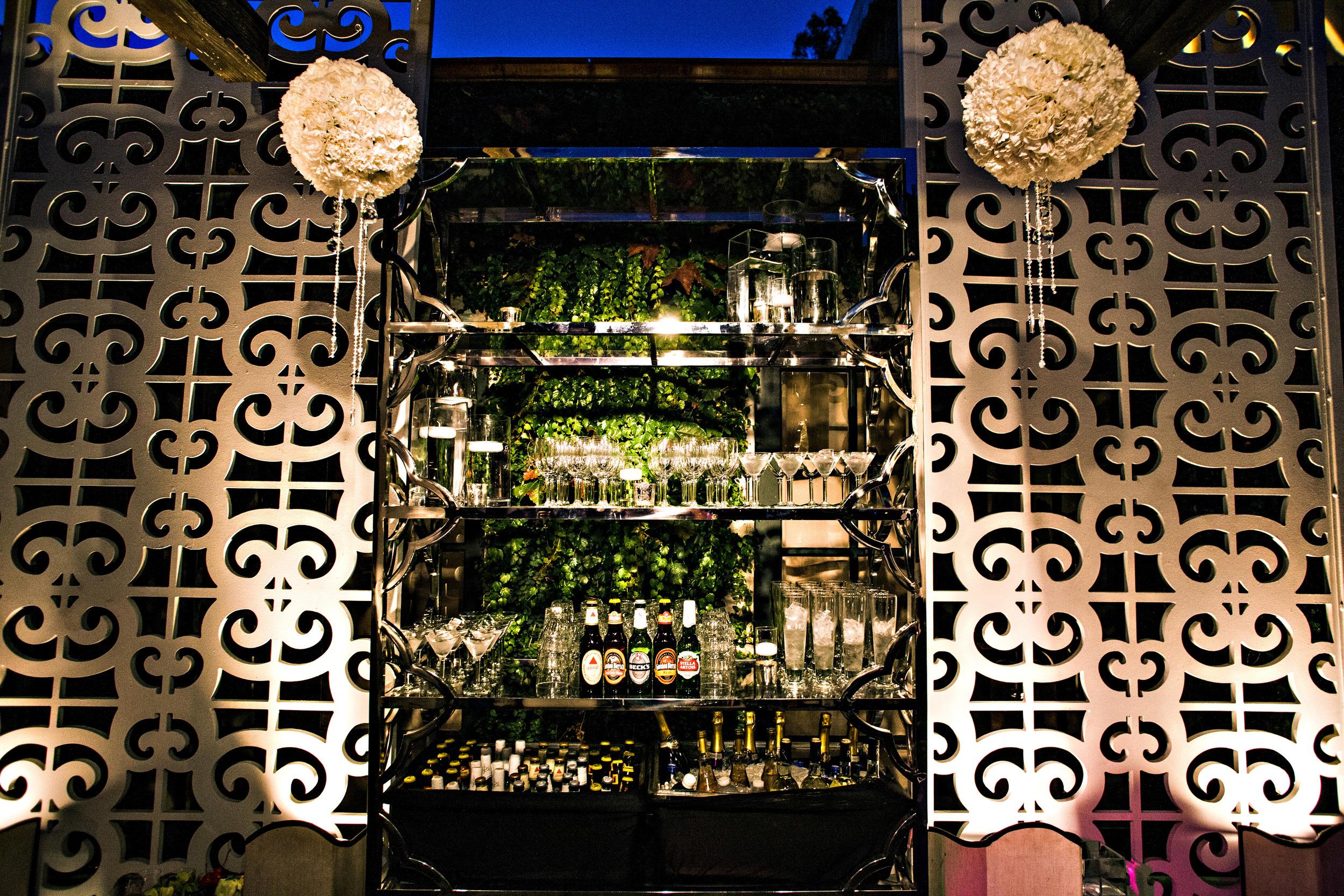36. modern romantic wedding, hanging pomeanders, hanging crystals, custom monogram on bar, reception bar .jpg