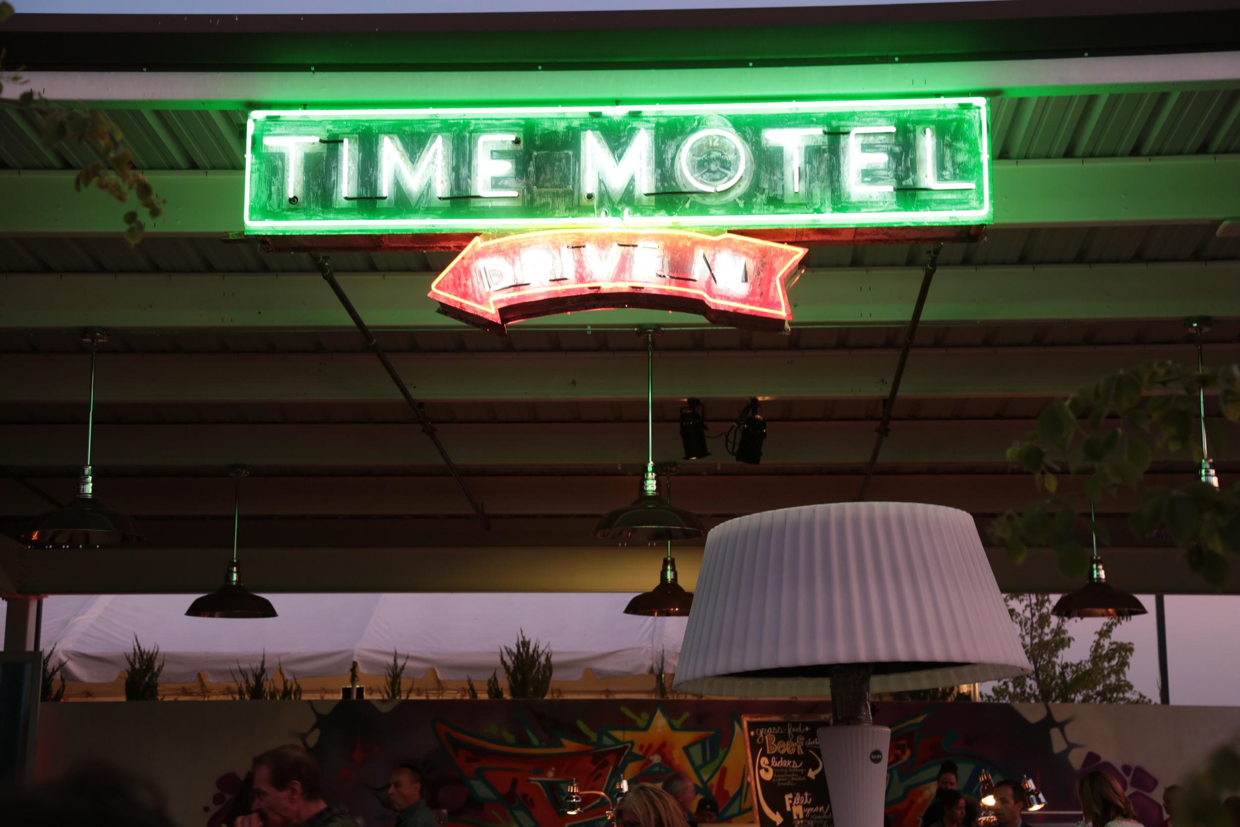 Munchkin time motel drive in neon.JPG