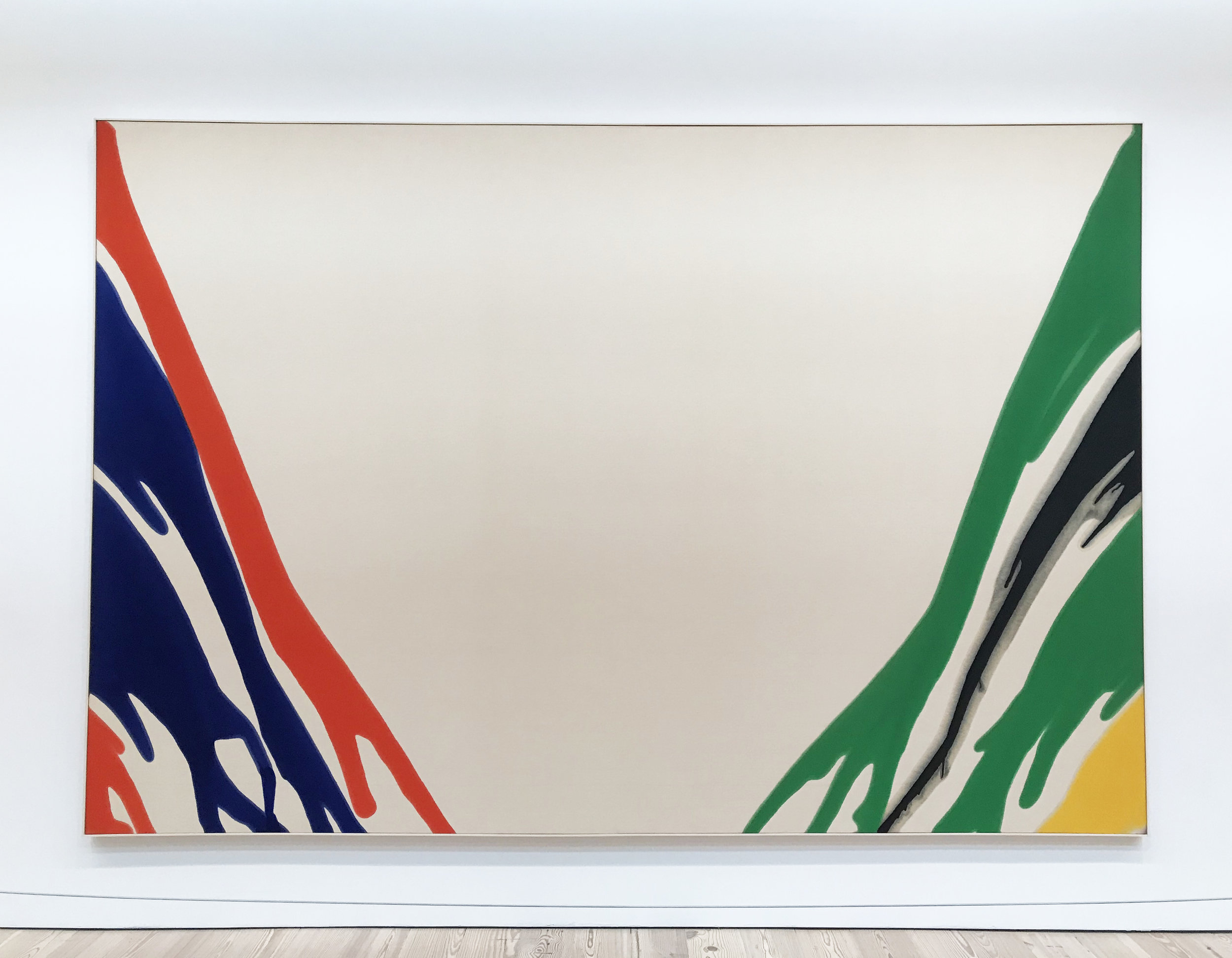 "'Gamma Delta' by Morris Louis, 1959-60. Magna on canvas.  I'd never heard of Magna before. It's a brand name of an acrylic resin paint developed in 1947.  ""In Morris Louis's Gamma Delta brightly colored, poured ribbons of paint uncoil to the bottom edge of the canvas, leaving a void in the center. Tom make the work, Louis stained the canvas by diluting and pouring synthetic paints onto its surface, allowing the colors to spread and bleed. Louis explored the technique for nine years, in response to the paintings of Jackson Pollock and especially to those of Helen Frankenthaler, whose studio Louis visited in 1953."""