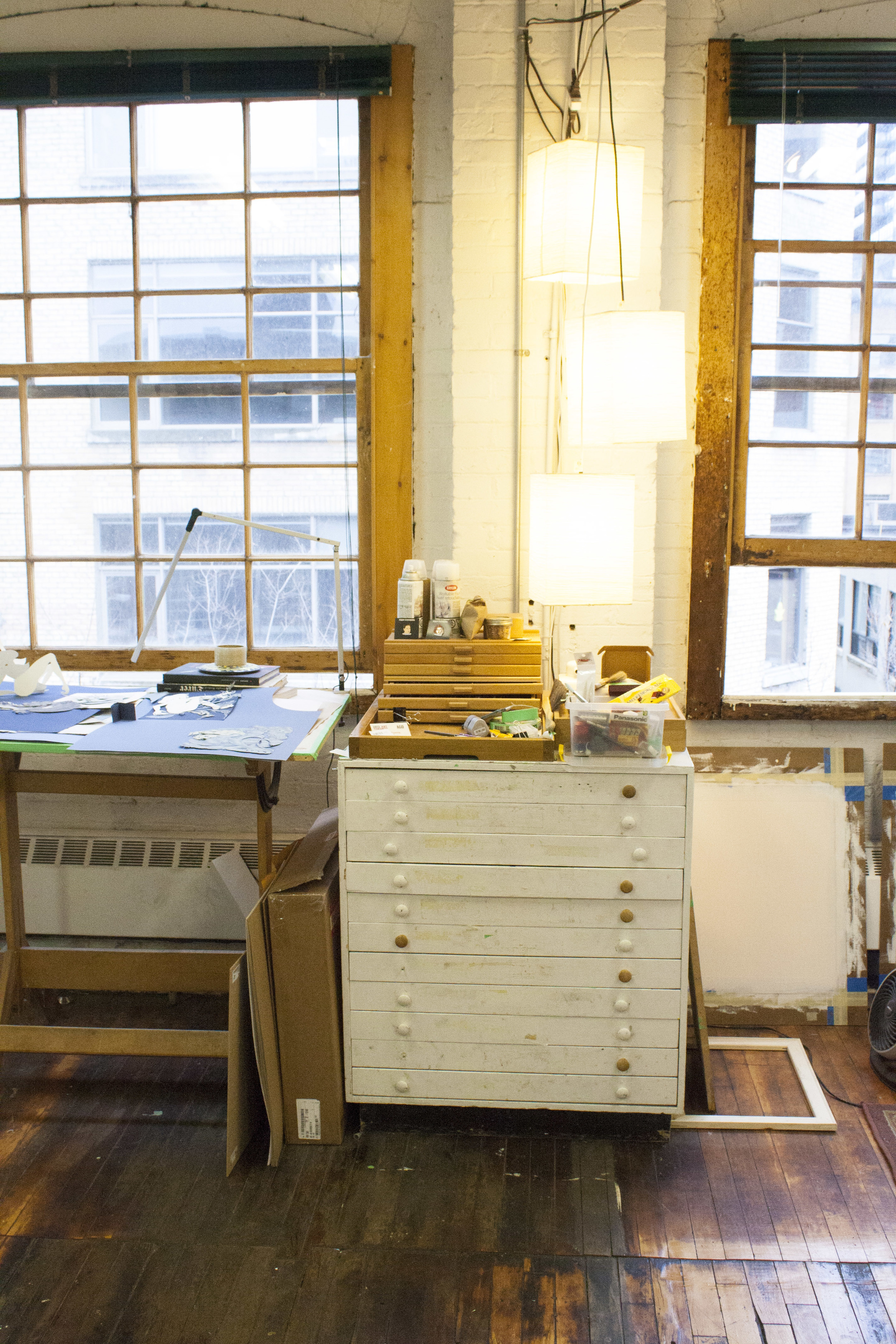 This flat file cabinet marks the dividing line between Winnie and her studio mate Kris Knight's work space.
