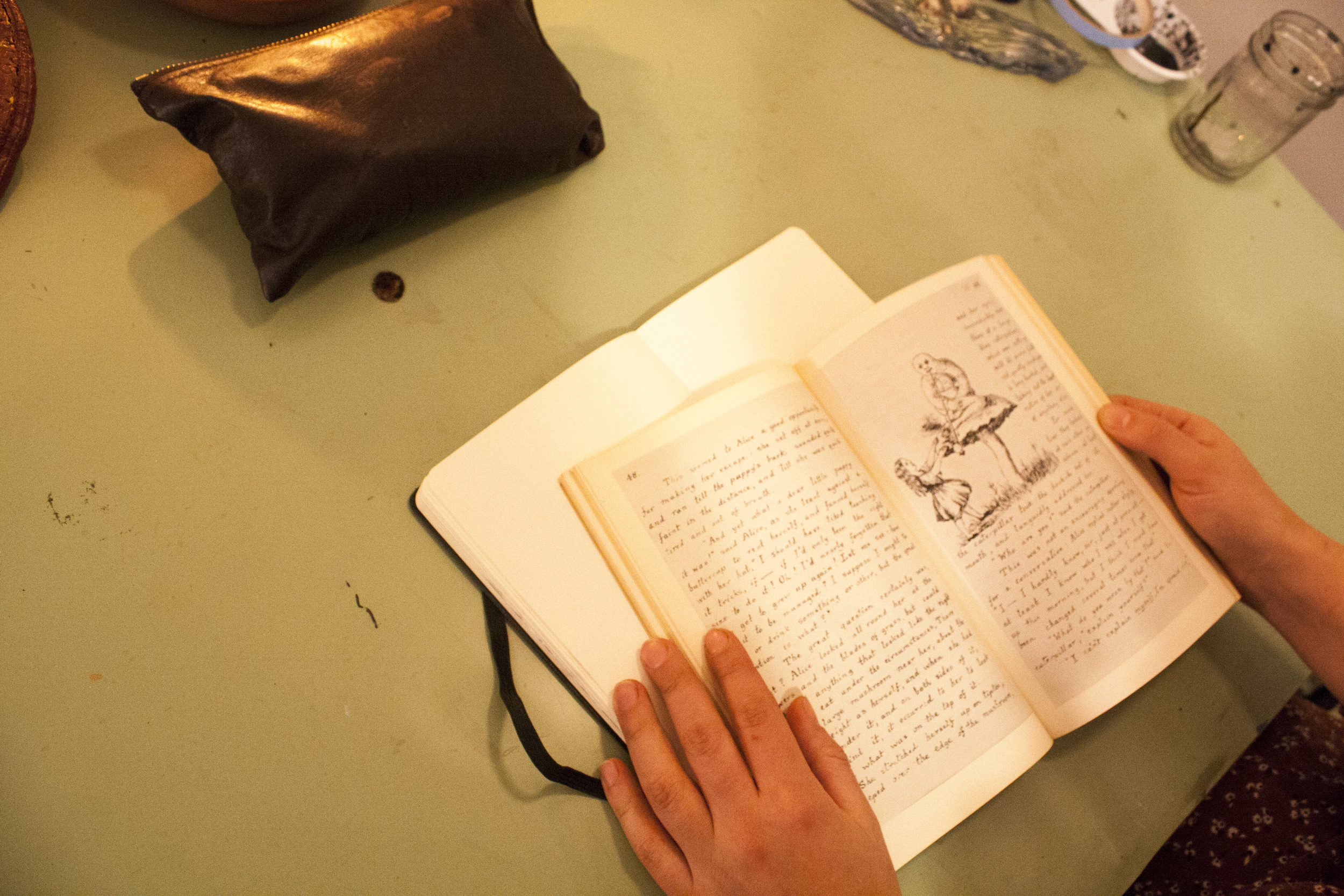 The pages of one of Juliana's most treasured books, Alice's adventures underground.