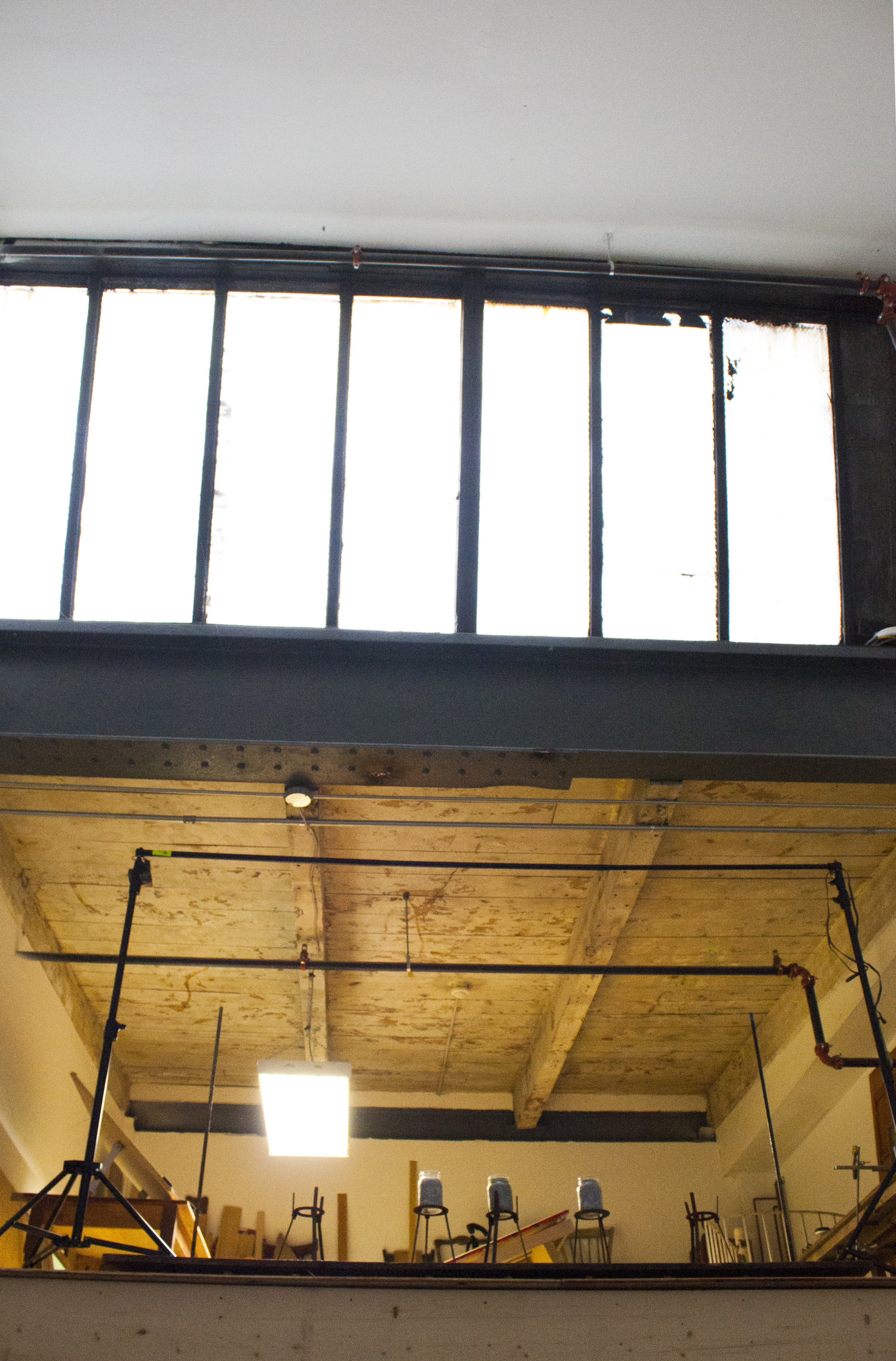 The back end of the shop is set in with two levels markian erected himself. The main area features 25 foot high ceilings and a large transom window.
