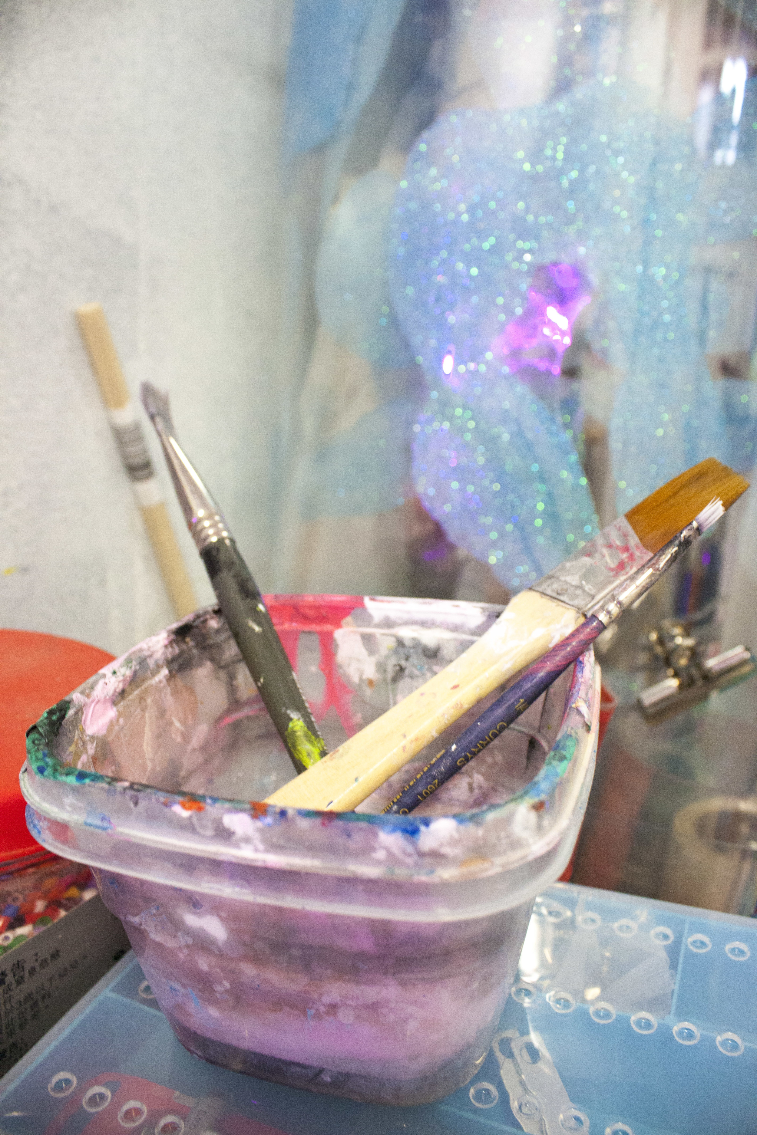 glue-gunked brushes from collaging.