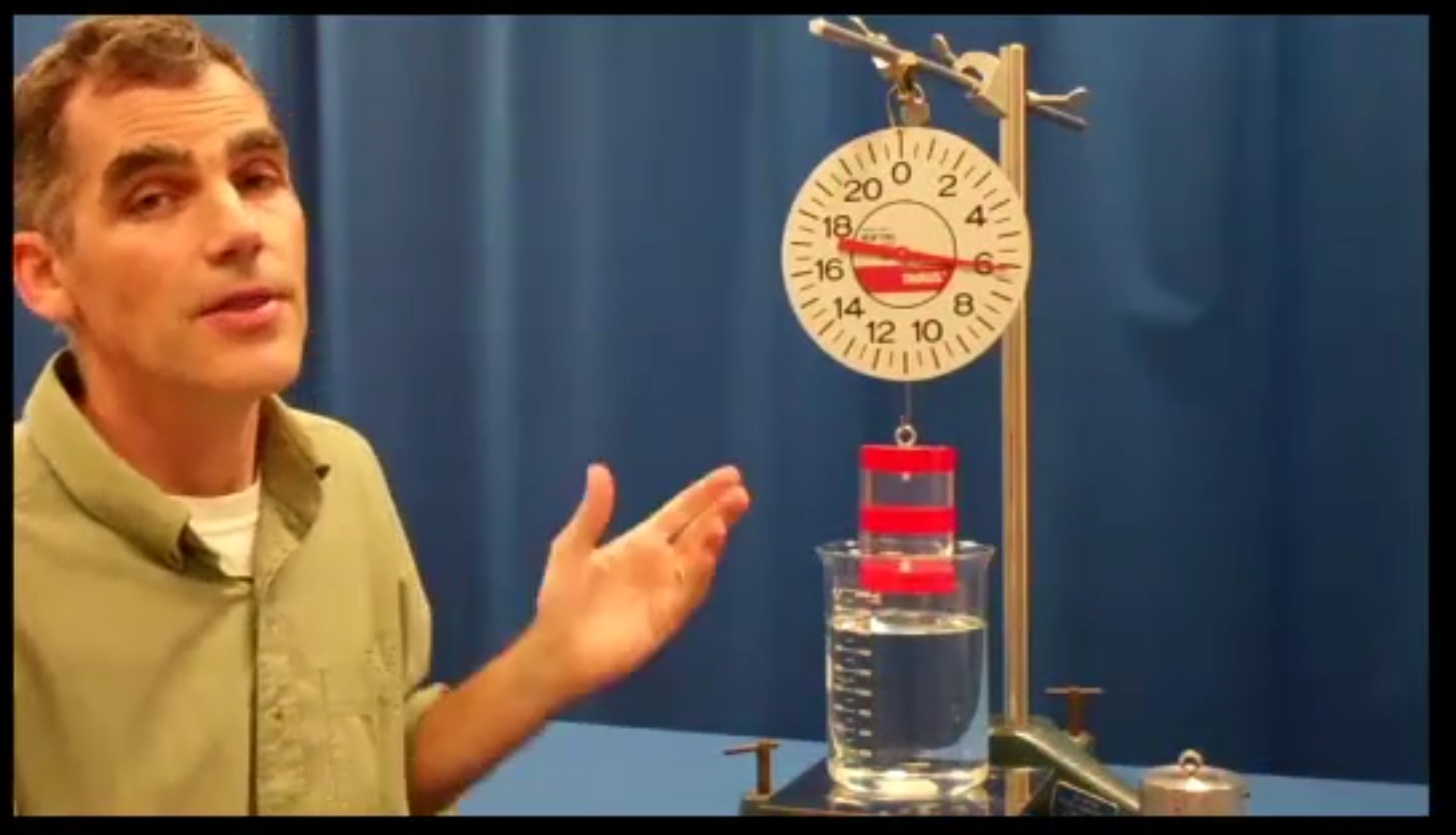 Professor Phillip Collins demonstrating buoyancy in an interactive video