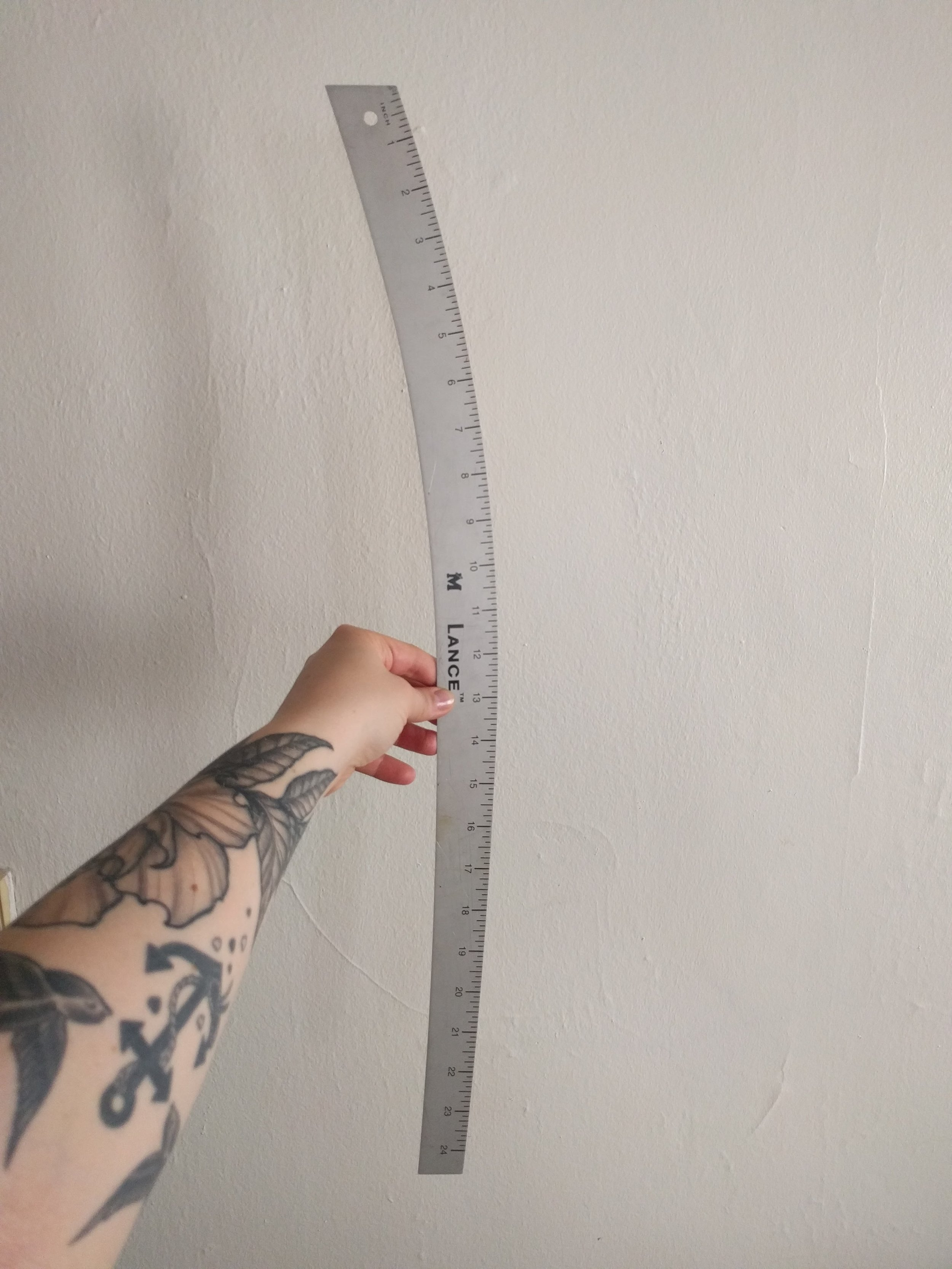 DRESS MAKER'S RULER  - TECHNICALLY, THIS IS A HIP CURVE RULER BUT IN A PINCH, IT WORKS JUST FINE FOR THIS TYPE OF PROJECT.  IF YOU DON'T HAVE A CURVE RULER, BE CREATIVE- THE MAIN GOAL IS TO KEEP THE CENTER FRONT (CF) STRAIGHT.