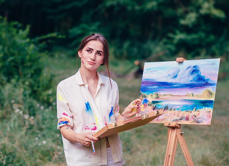 artist woman landscape painting