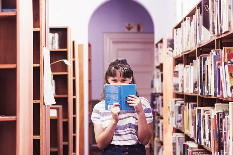 girl with book in library cute