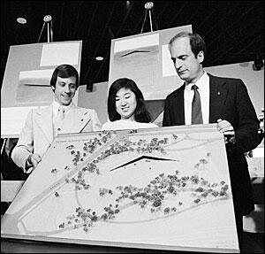 Jan Scruggs, Maya Lin, and Bob Doubek with a model of Lin's design for the Vietnam Veterans Memorial   Doubek, Scruggs, and Wheeler stood together against the opposition. After the compromise of adding a statue and a flagpole to the site, groundbreaking proceeded as planned. Nevertheless, the design debate raged until the dedication ceremony. Even after the dedication, there were disagreements about where to place the statue and flagpole.  One factor not discussed by Doubek is the tremendous psychological and spiritual impact the Memorial has exerted on Vietnam War veterans. In dozens of memoirs I have read, veterans cite visits to the Wall as turning points in their lives. In a somewhat magical way, the sight of the Wall and the visitors surrounding it gives many veterans a clearer understanding of the war and their involvement in it.  To me, this effect above all else validates the construction of the Memorial.  —Henry Zeybel