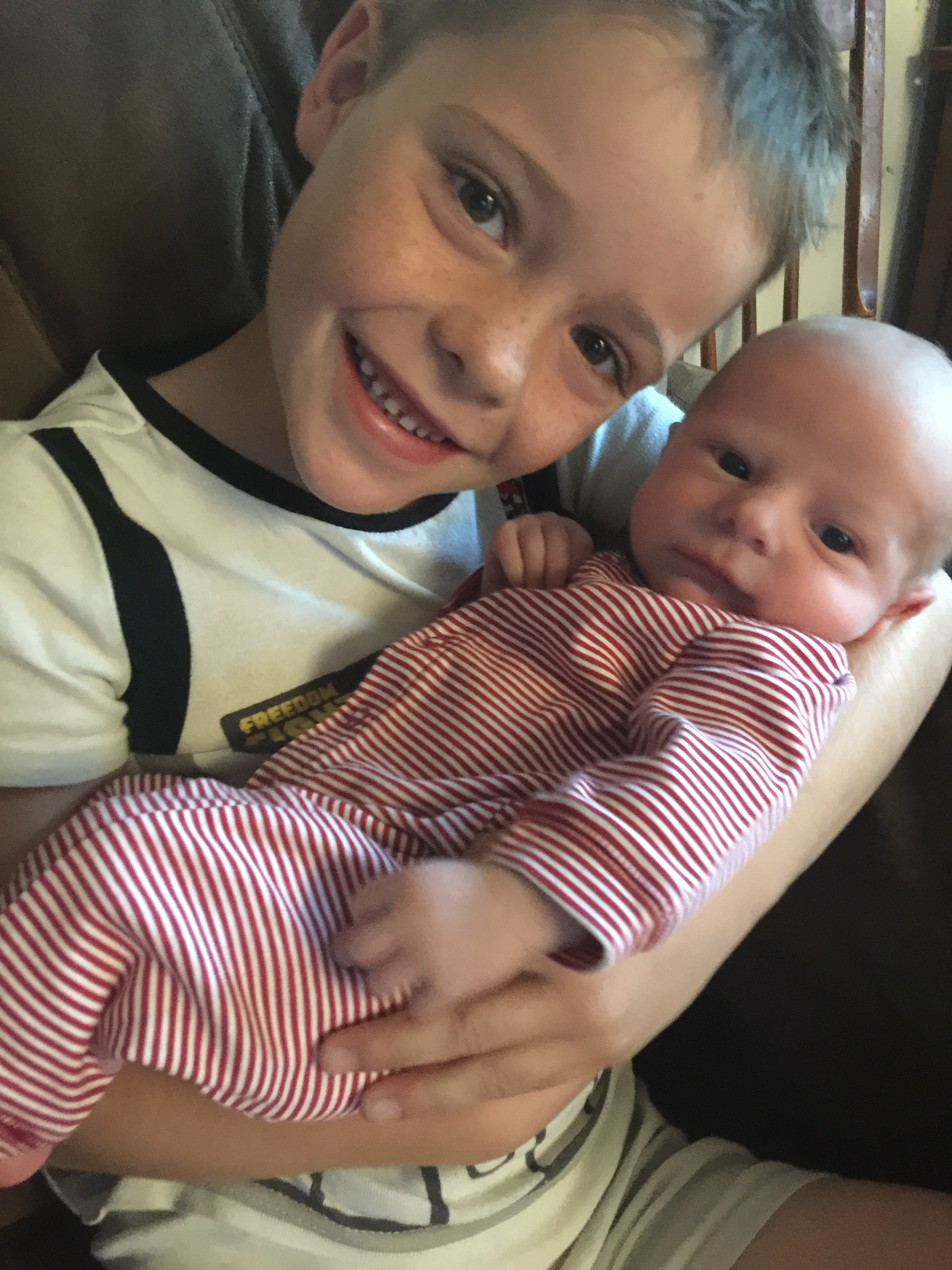 Quinn is a big helper with quade and can't get enough of his little brother!