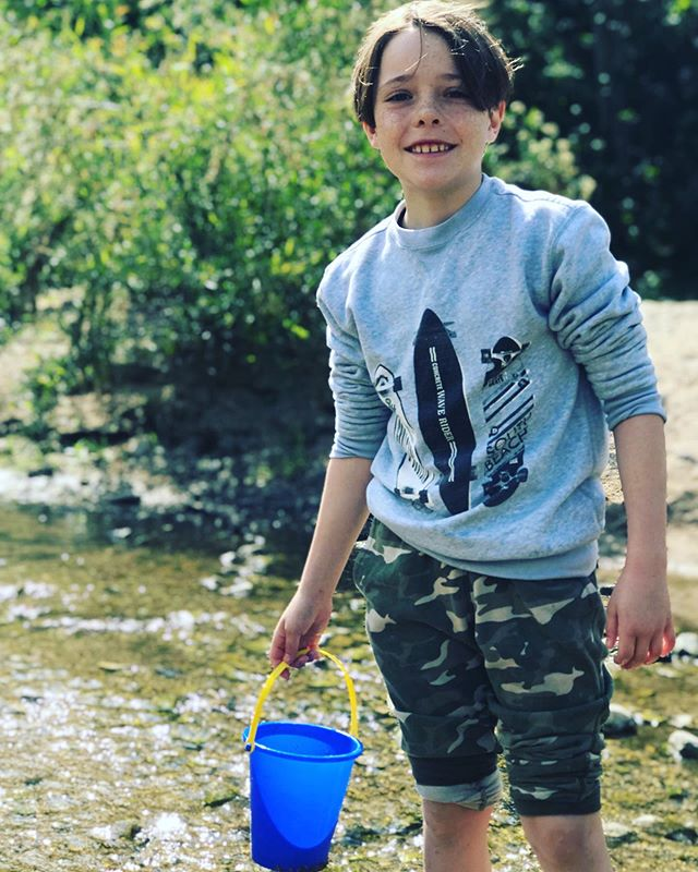 """This week, I took all 4 boys to check out a homeschool group. I had no idea how the demographics would be and it turned out that none of the moms had school aged kids so no commiserating on that end, but we had a happy time playing in the creek and catching tadpoles. Even though the big boys didn't have kids their age to play with, they made the best of it. As the morning progressed, mom after mom came to me to express how wonderful and kind and helpful my boys were with their little ones. I had noticed too. They were quick to help the toddlers navigate unsteady rocks and share their buckets and shovels. They had cheerful dispositions and were polite to the other moms. It's easy to be caught in a chapter of parenting that is hard and to then imagine that all the efforts we make aren't having an impact on our kids, but this particular morning breathed life into my mama heart. I got to see how the thousands of times I have pointed my kids to Christ-like behavior have shaped them. Our kids listen to our words and read our actions, even though it seems like we may not be reaching their hearts. I was encouraged to keep doing the good parenting! And I want to encourage you too! Spend their childhood doing the next right thing and trust that God is, indeed, making something beautiful out of their lives. """"Start children off on the way they should go, and even when they are old they will not turn from it."""" (Proverbs 22:6)"""