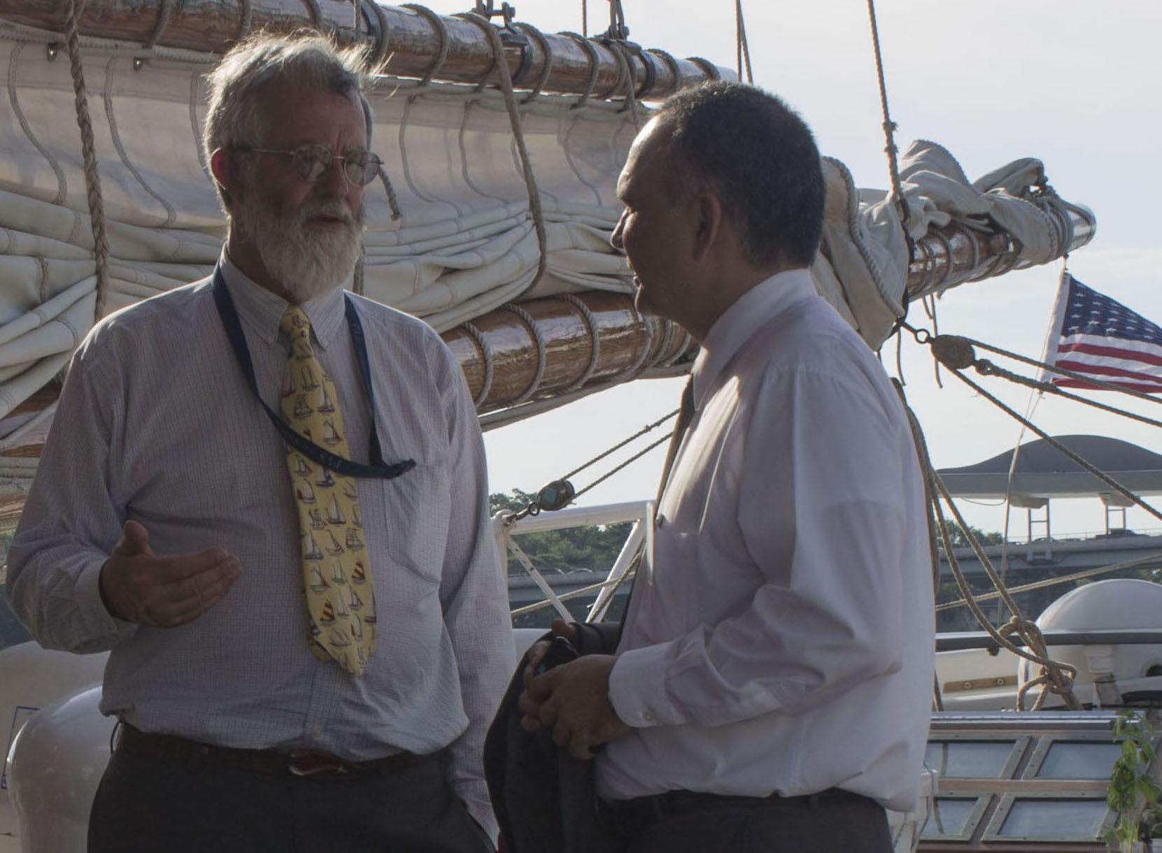 Boris Luis Gómez (R), First Secretary in the Embassy of the Republic of Cuba, tours the ship with boat owner Phineas Sprague
