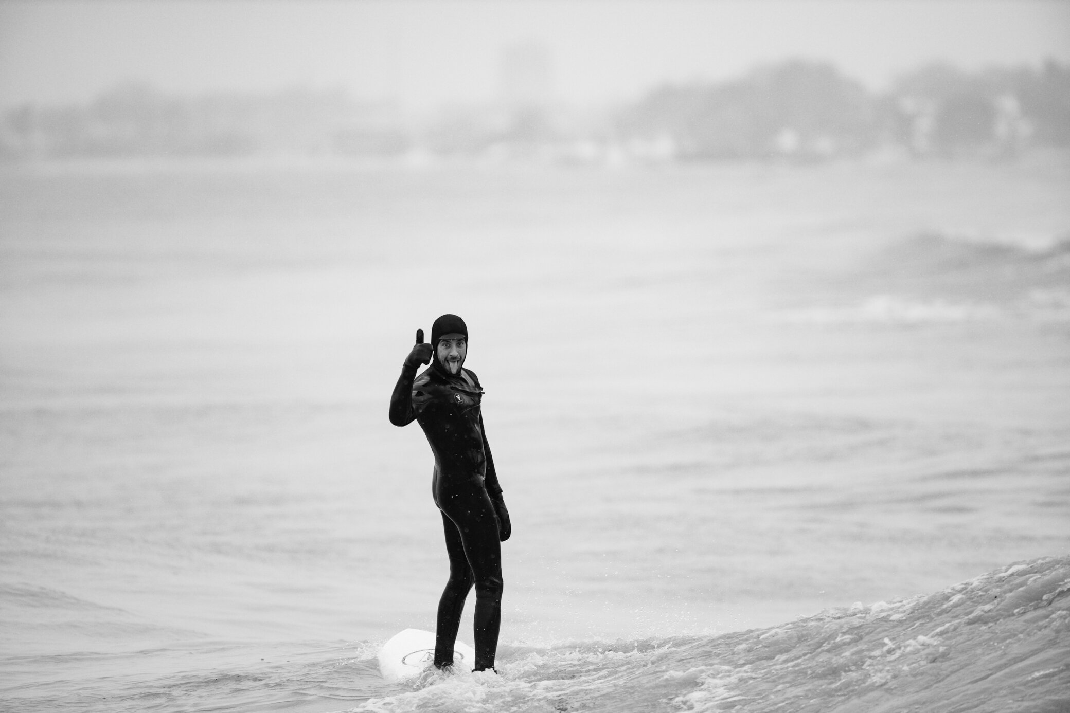 Jake Bresette, owner of Lake Effect Surf Shop….. he is the one that invites me out and he posed for this shot as he spotted me getting soaked on the rocks.