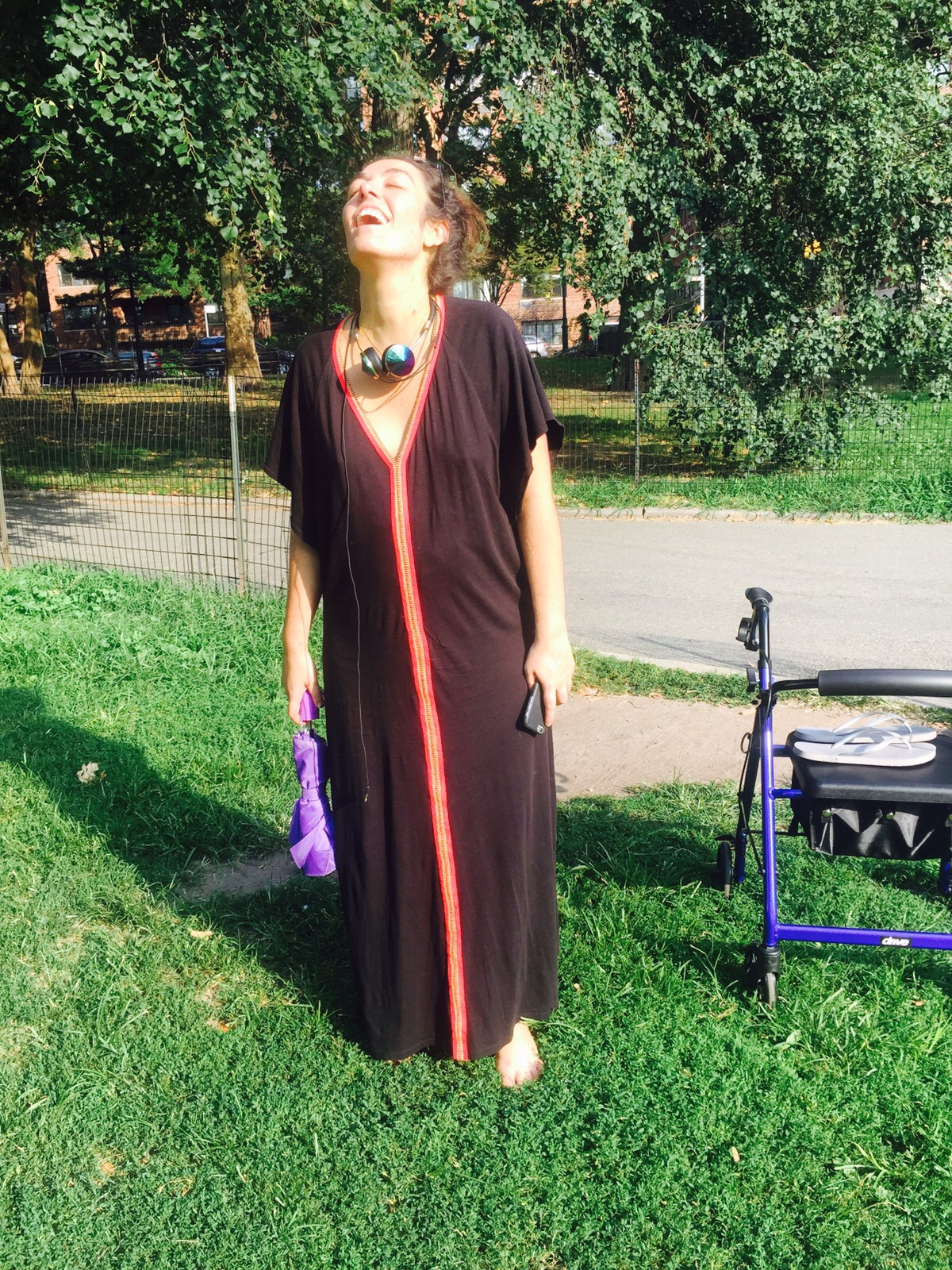 Genuine elation at stepping on grass for the first time after hospital, which was one of my goals. Photos and goals thanks to the incomparable Karina Geiger. Beautiful abaya covering my massively stretched body thanks to  Pitusa . Check the umbrella I'm holding, doubles as parasol.