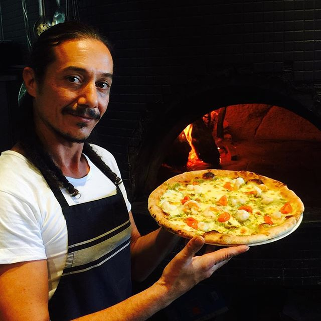 Our man Steto doing what he does best! $15 pizzas tonight and happy hour till 7pm. #omgyum #pizza #newpizzamenu