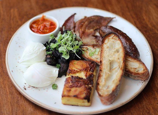 Breakfast done right. Butchers sausage, bacon, mushrooms, potato gratin, poached eggs, @amano_nz ciabatta.  #richmondrdcafe #hipgrouplife #greylynn #ponsonby