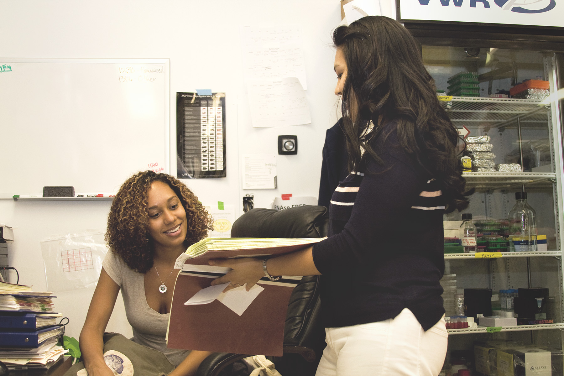 Meghin and Tabia discuss a set of lab test results.
