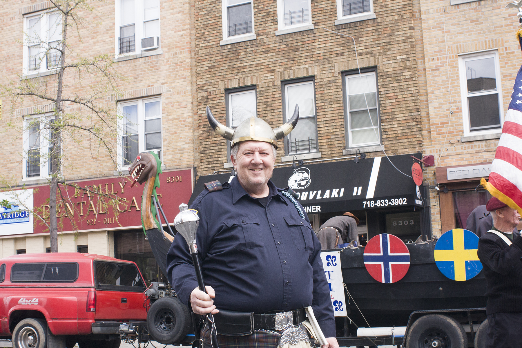 A local Viking poses in front of his ship before the parade begins.